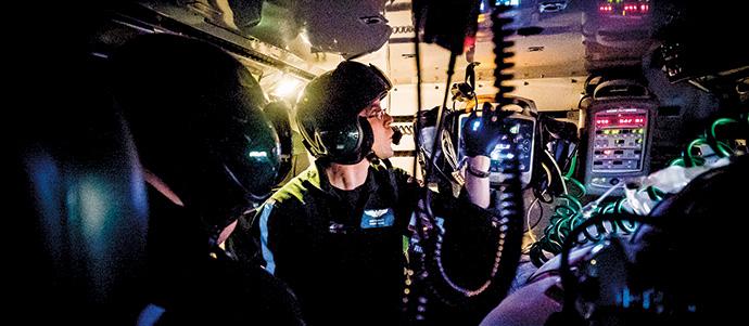 Life Flight nurse checks vital signs