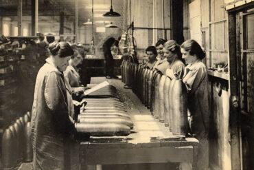 women inspecting howitzer shells