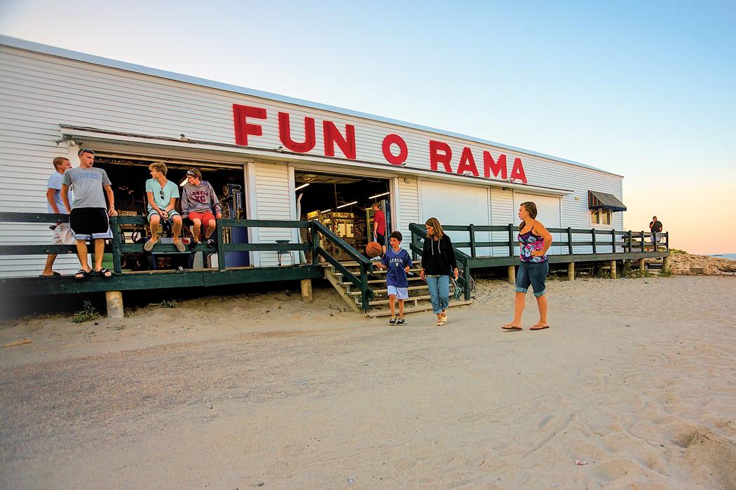 people around an arcade on the beach