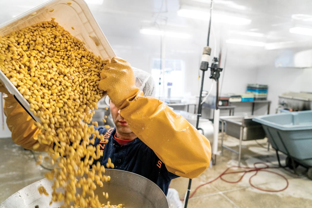 Jeff Wolovitz grinding organic soy beans for Heiwa Tofu