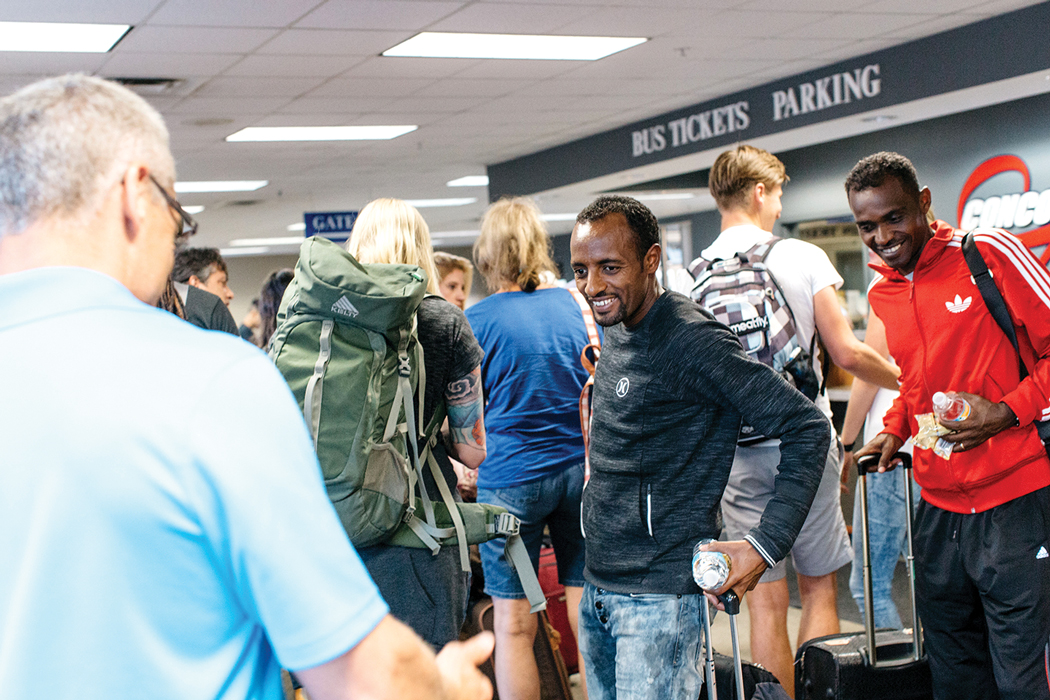 Tariku, center, and Markos arrive at the Portland bus terminal on an August evening after making an 18-hour trip from Ethiopia.