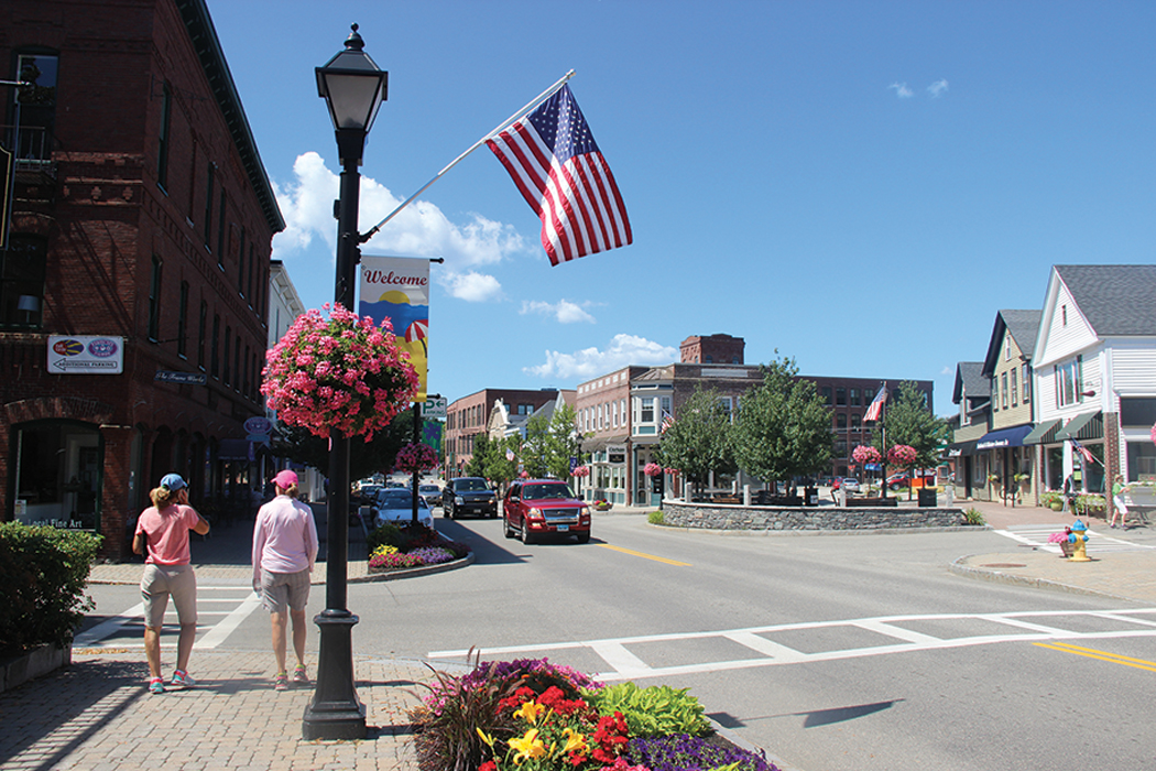 Flowers line Main Street in downtown Kennebunk
