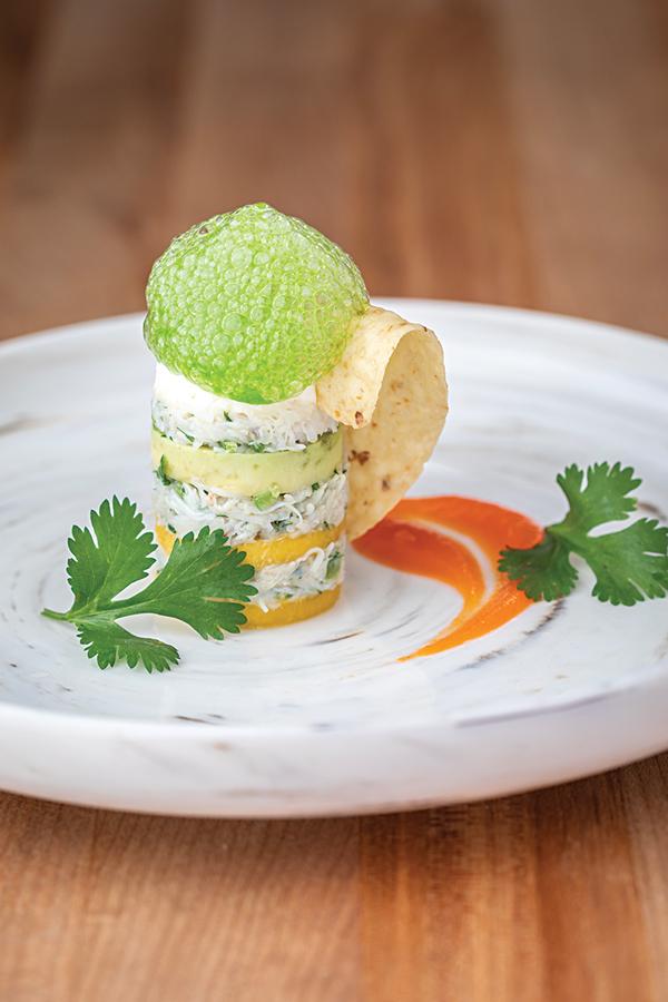 Cilantro foam on a crab, avocado, and mango tower uses Foam Magic powder.