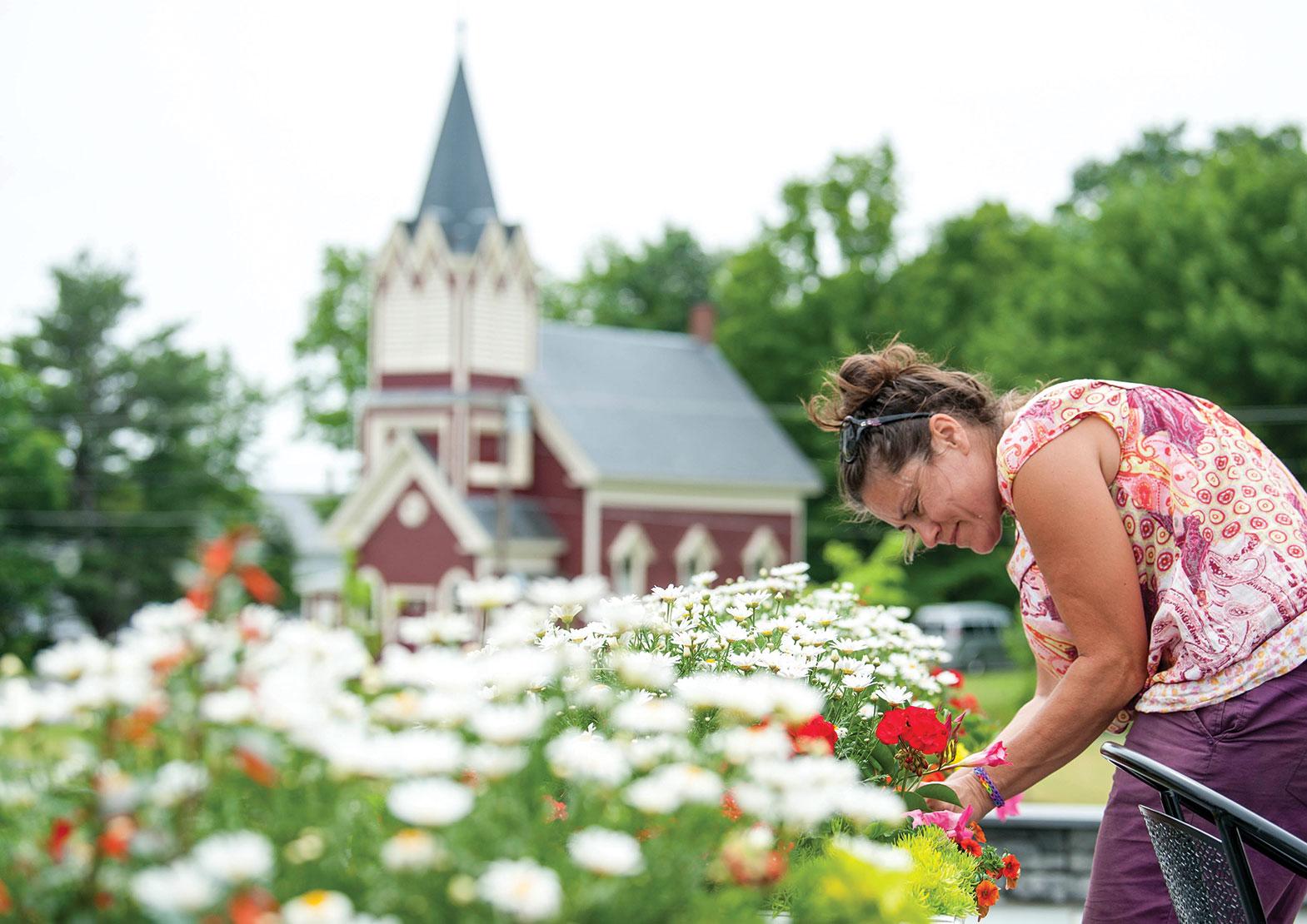 Tara Hall tends flowers outside the Monson General Store.