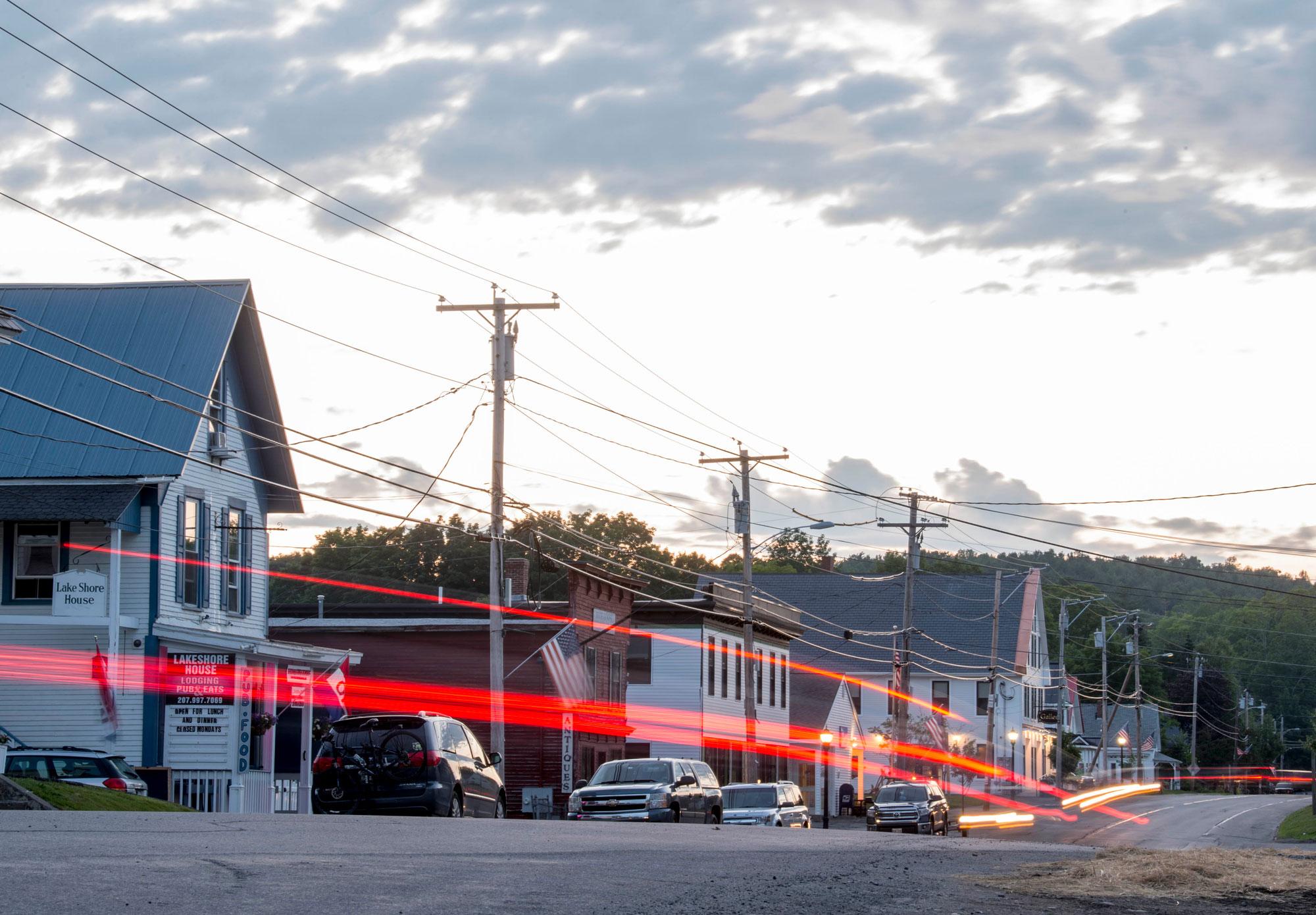 Traffic flows down Main Street in Monson, Maine
