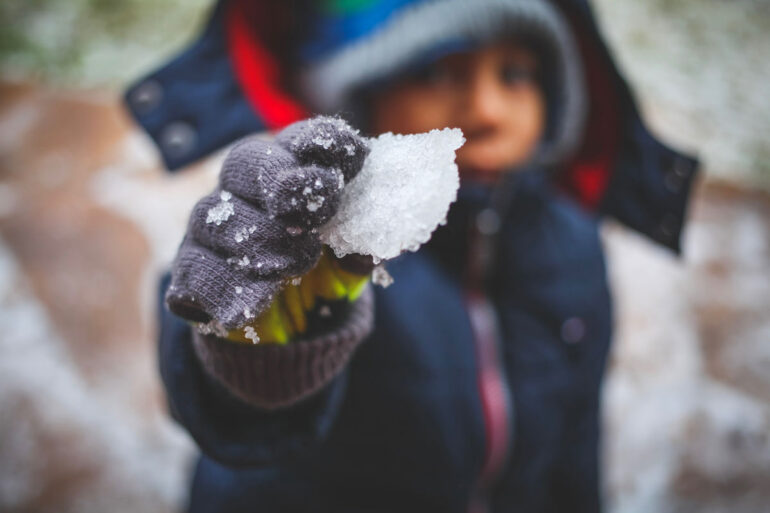 kid playing with snow