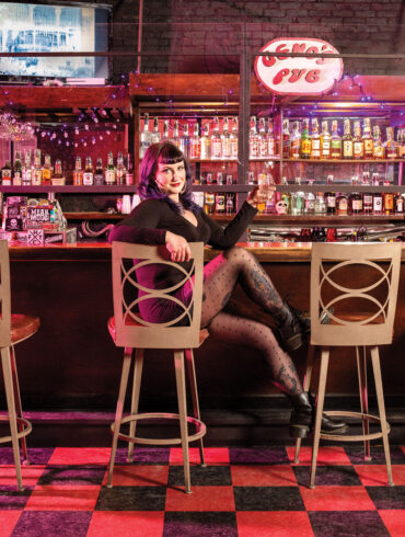 Kathryn Taylor at the bar of Geno's Rock Club