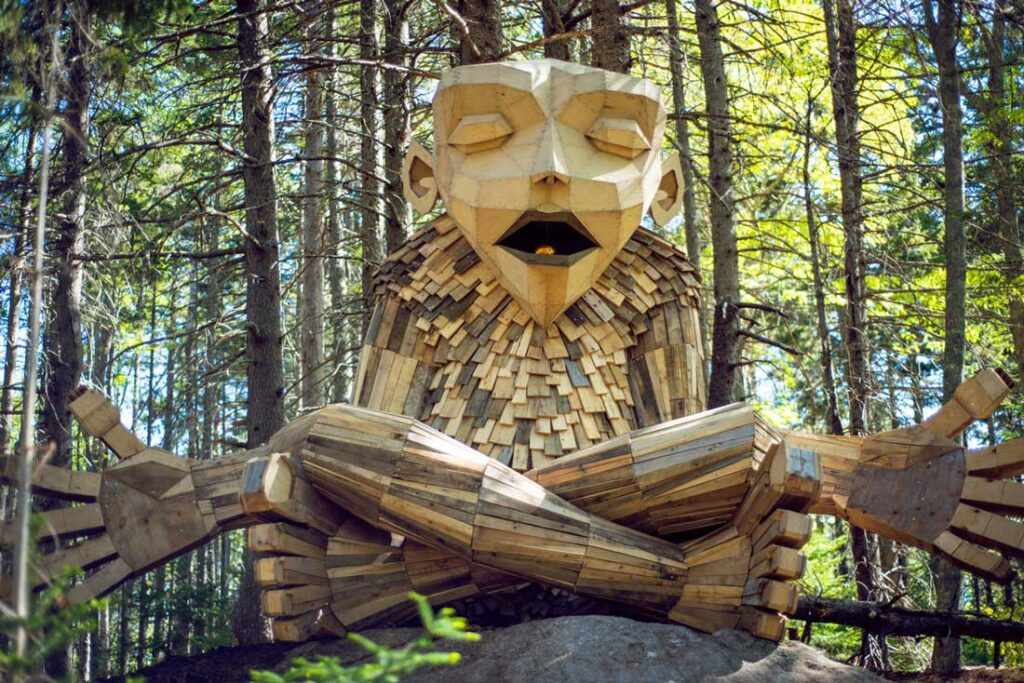 A giant troll practicing mindfulness in the woods of the Coastal Maine Botanical Gardens in Boothbay Harbor