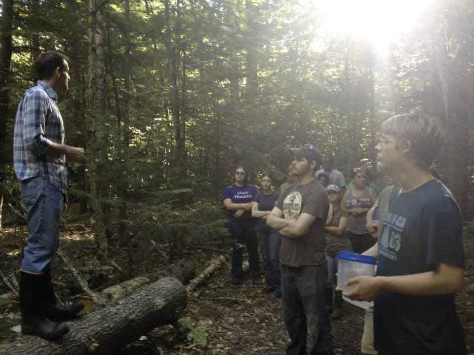 Unity students attend class in the woods