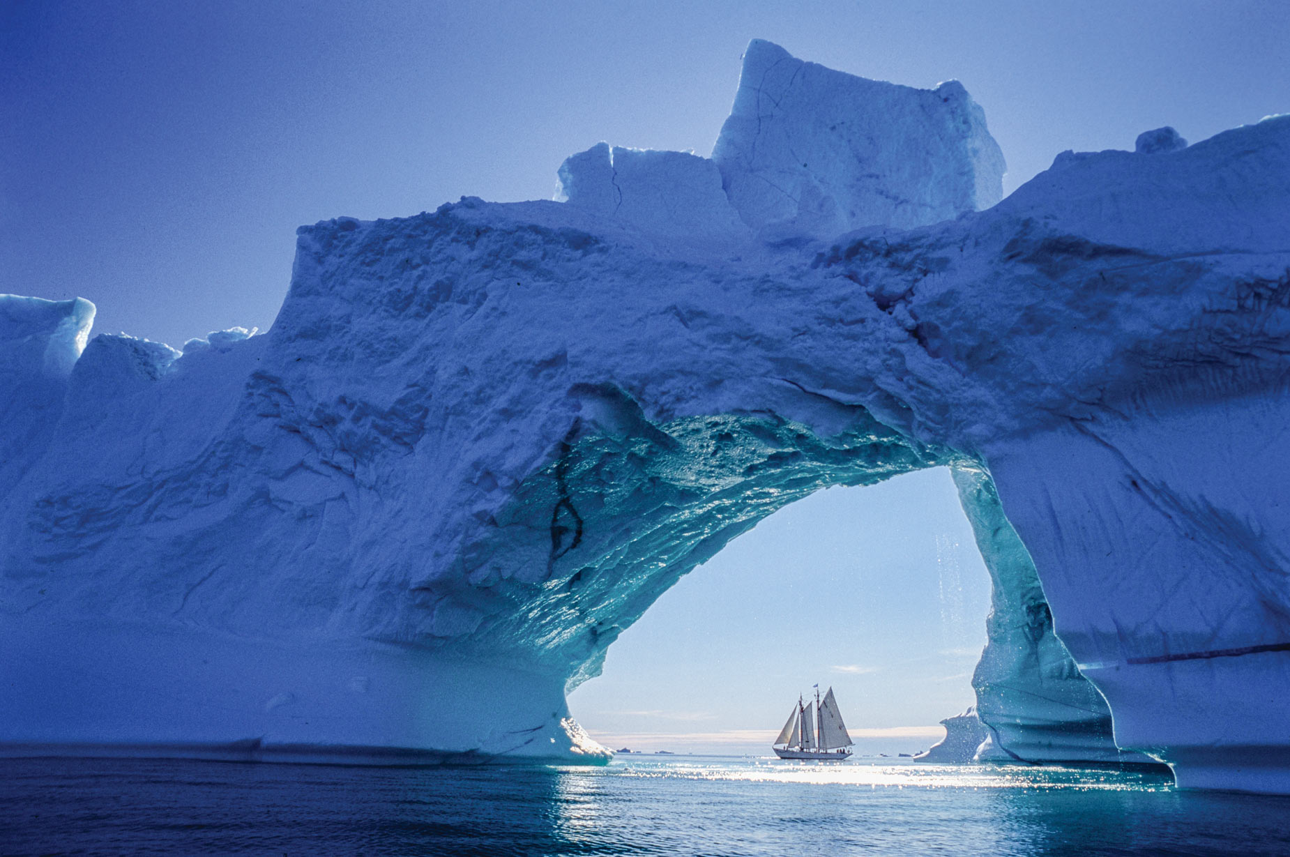 In 1991, in Disko Bay, on Greenland's west coast, the schooner Bowdoin passed an iceberg with a dramatic arch.
