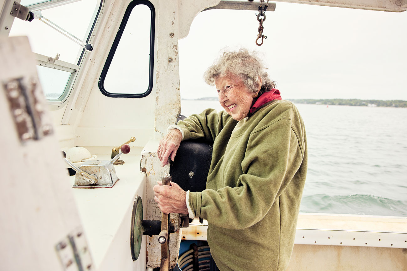 Virginia Oliver, 101, at the helm of her lobsterboat