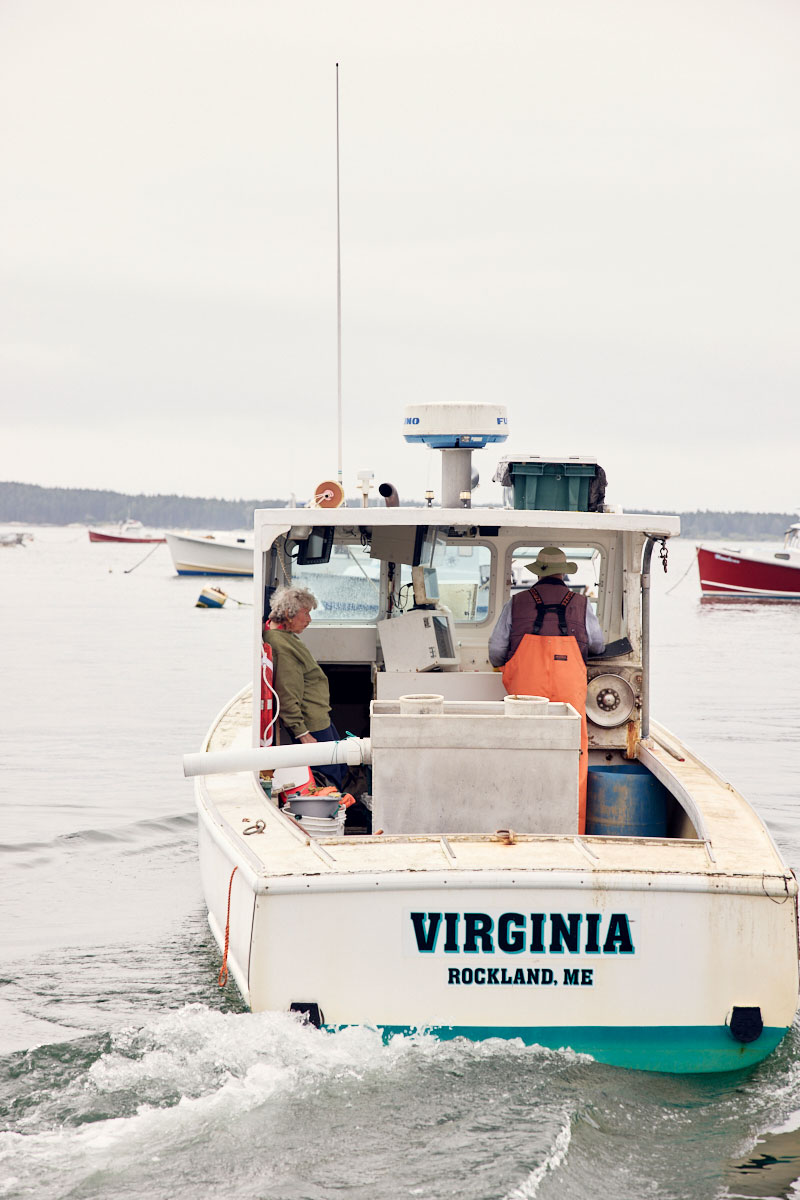 101-year-old lobsterwoman Virginia Oliver on her lobsterboat with her 78-year-old son Max at the helm